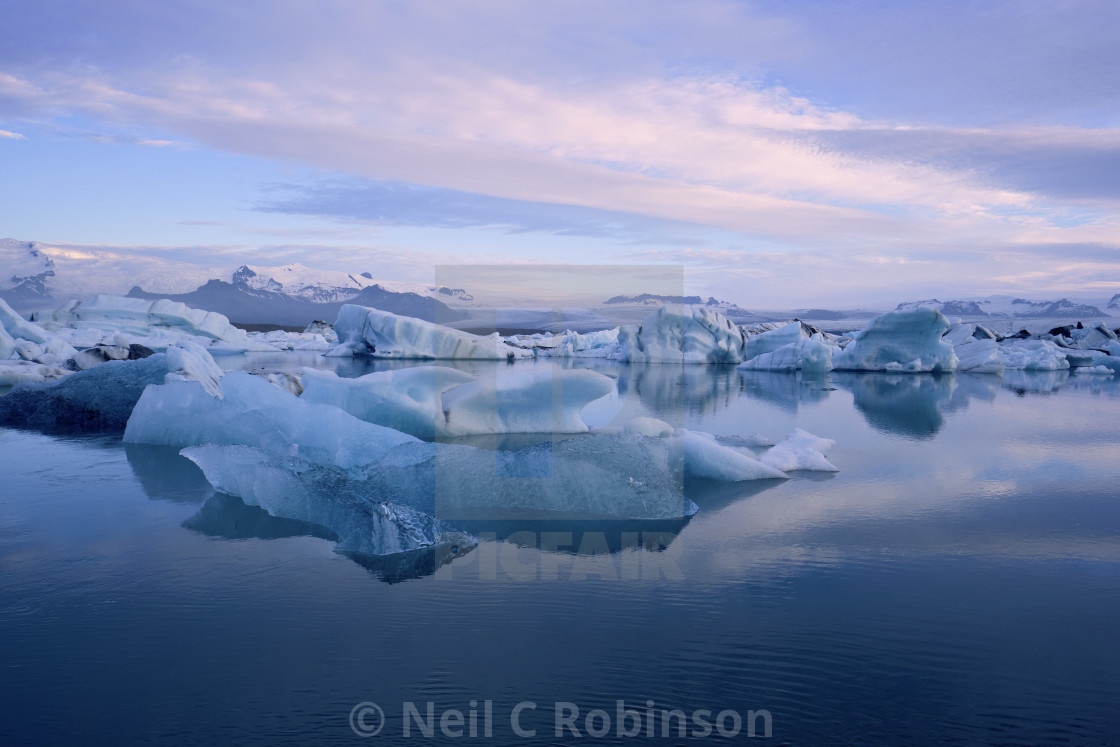 """Melting icebergs floating in a glacial lagoon"" stock image"