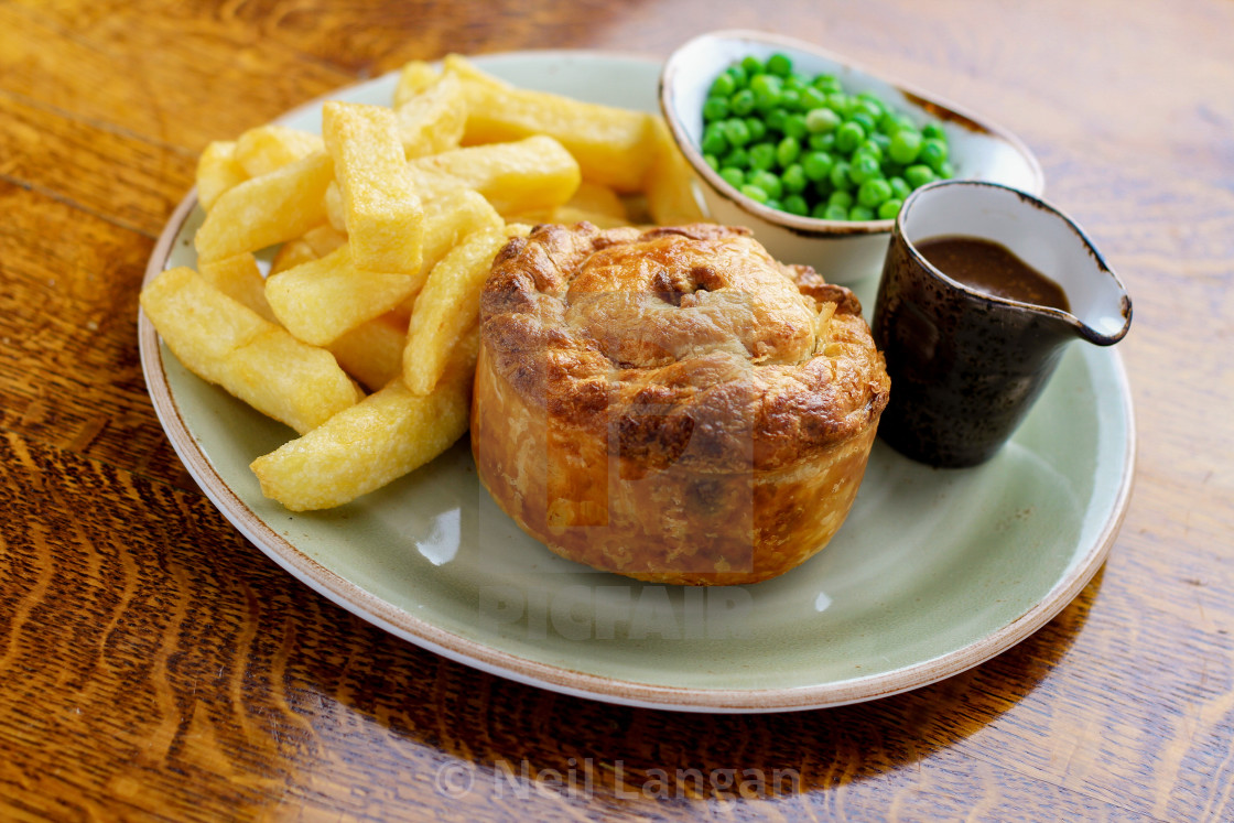 plated steak pie and chips dinner - License, download or ...