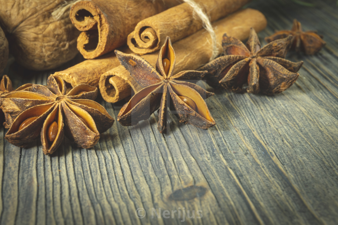 Bunch Of Cinnamon And Star Anise On Wooden Table License