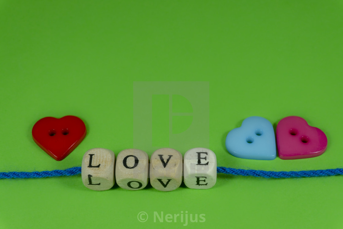 Heart shaped buttons and word Love on blocks - License