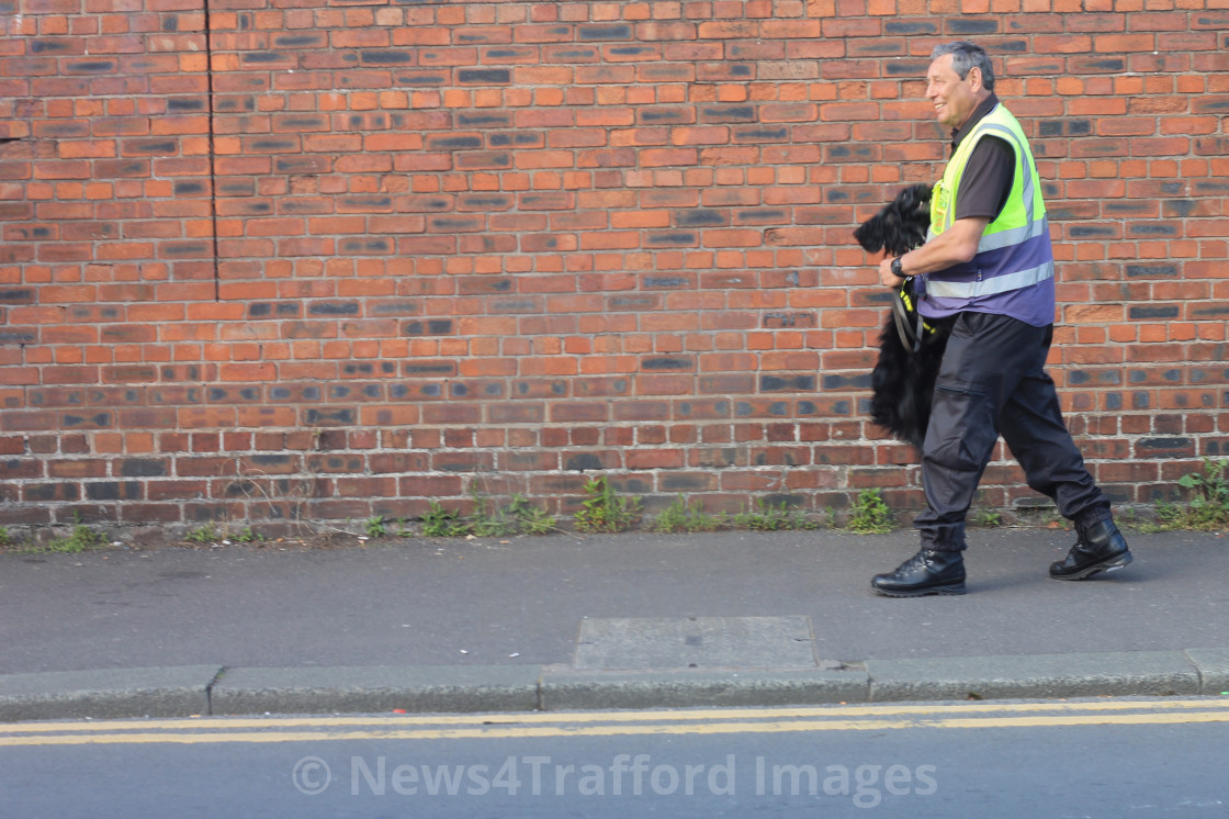 """One Man And His Sniffer Dog"" stock image"