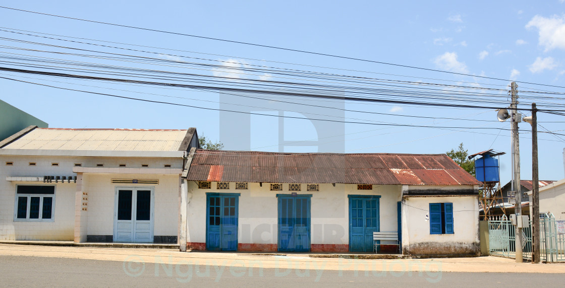 """Dalat old houses with blue doors"" stock image"