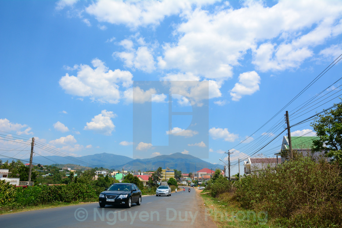 """Mountain road at rainy day with clouds"" stock image"