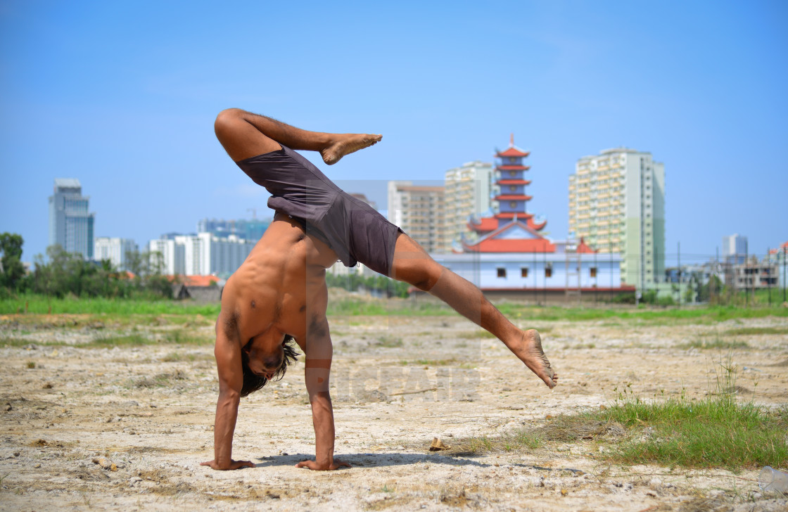 Young Indian Man Doing Yoga Exercise In The Park License Download Or Print For 4 96 Photos Picfair