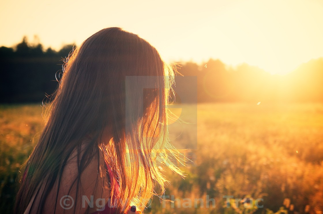 """Young woman enjoying sunlightGirl"" stock image"