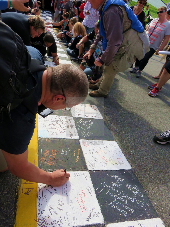 Male Signing The Start Finish Line At The Daytona 500 License