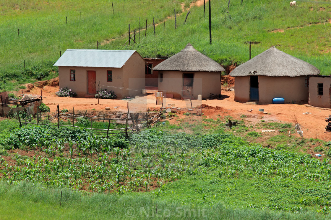 """Small rural settlement in mountainous grassland, KwaZulu-Natal, South Africa"" stock image"