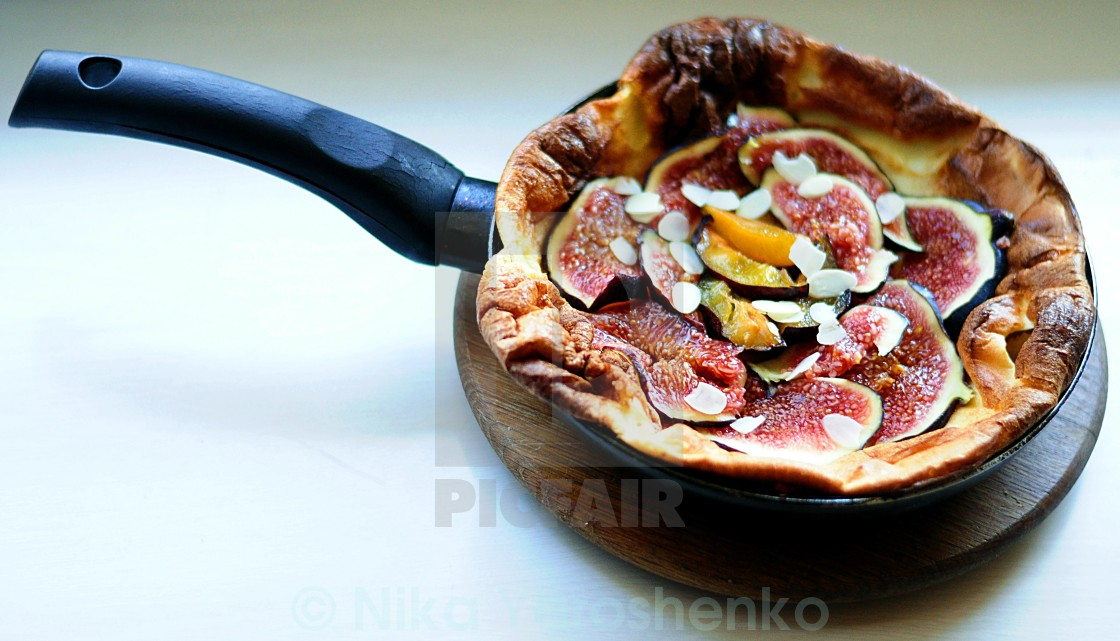 """Baked pancake with plum and fig"" stock image"