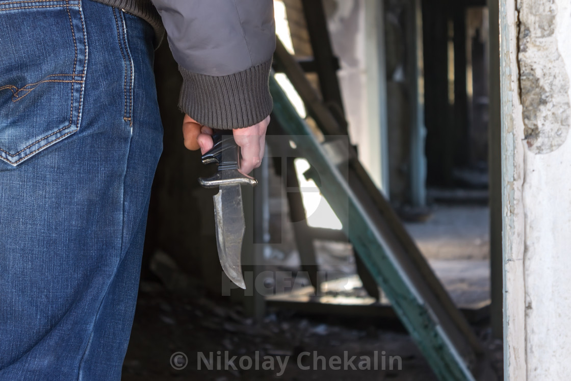 A Man With A Knife In His Hand In An Abandoned Building Is Ready To Kill License Download Or Print For 12 40 Photos Picfair