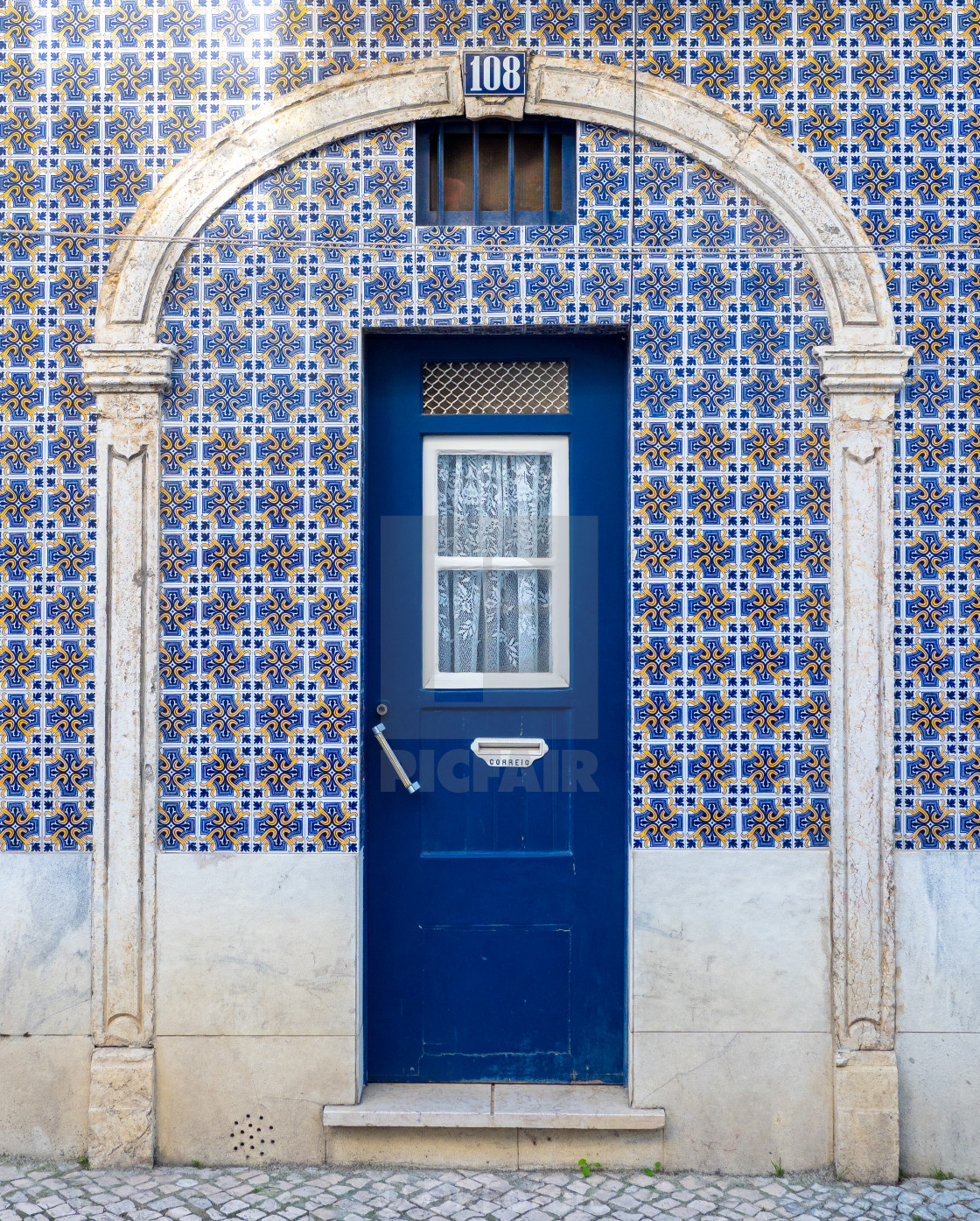 """Lisbon house door with azulejos tiles"" stock image"