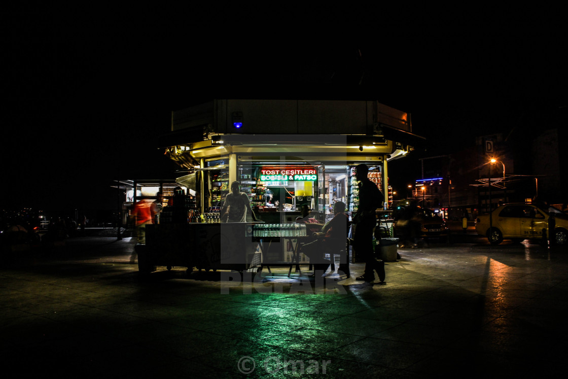 """A kiosk at night"" stock image"