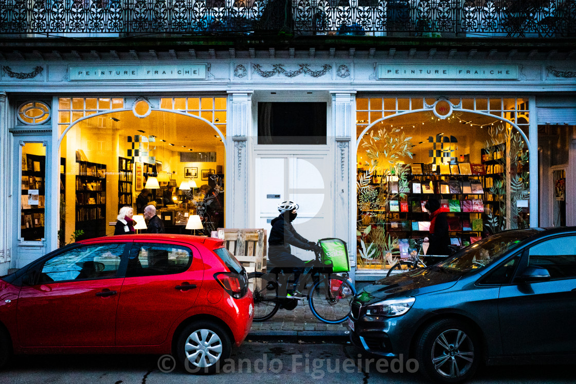 """Cyclist in front of bookshop window"" stock image"