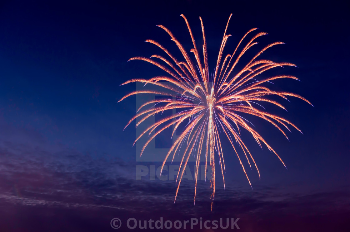 """""""Aerial firework exploding on a calm summers evening"""" stock image"""