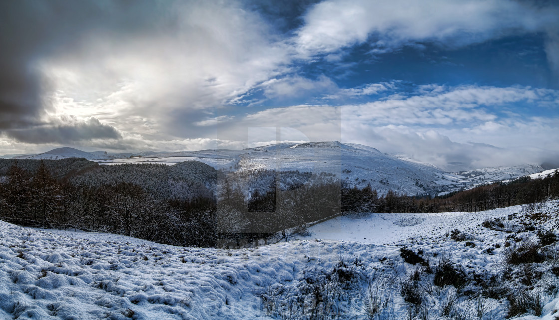 """Crookstone Knoll and Jaggers Clough in the snow"" stock image"