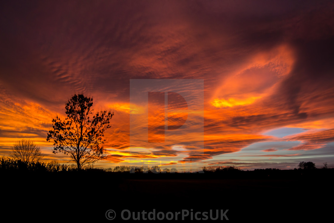 """Sunset with a cloud fallstreak"" stock image"