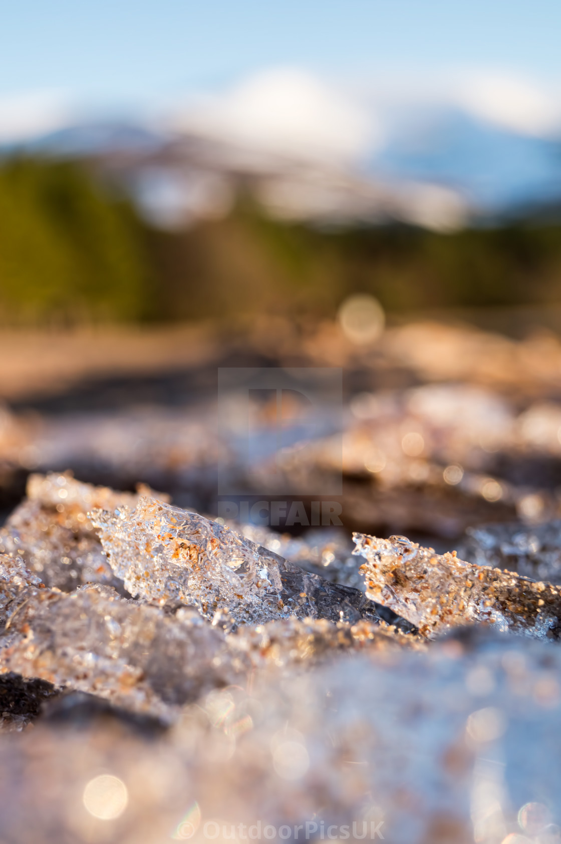 """Broken ice on sandy beach"" stock image"