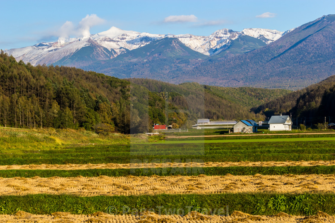 """Central Hokkaido farm and mountains"" stock image"