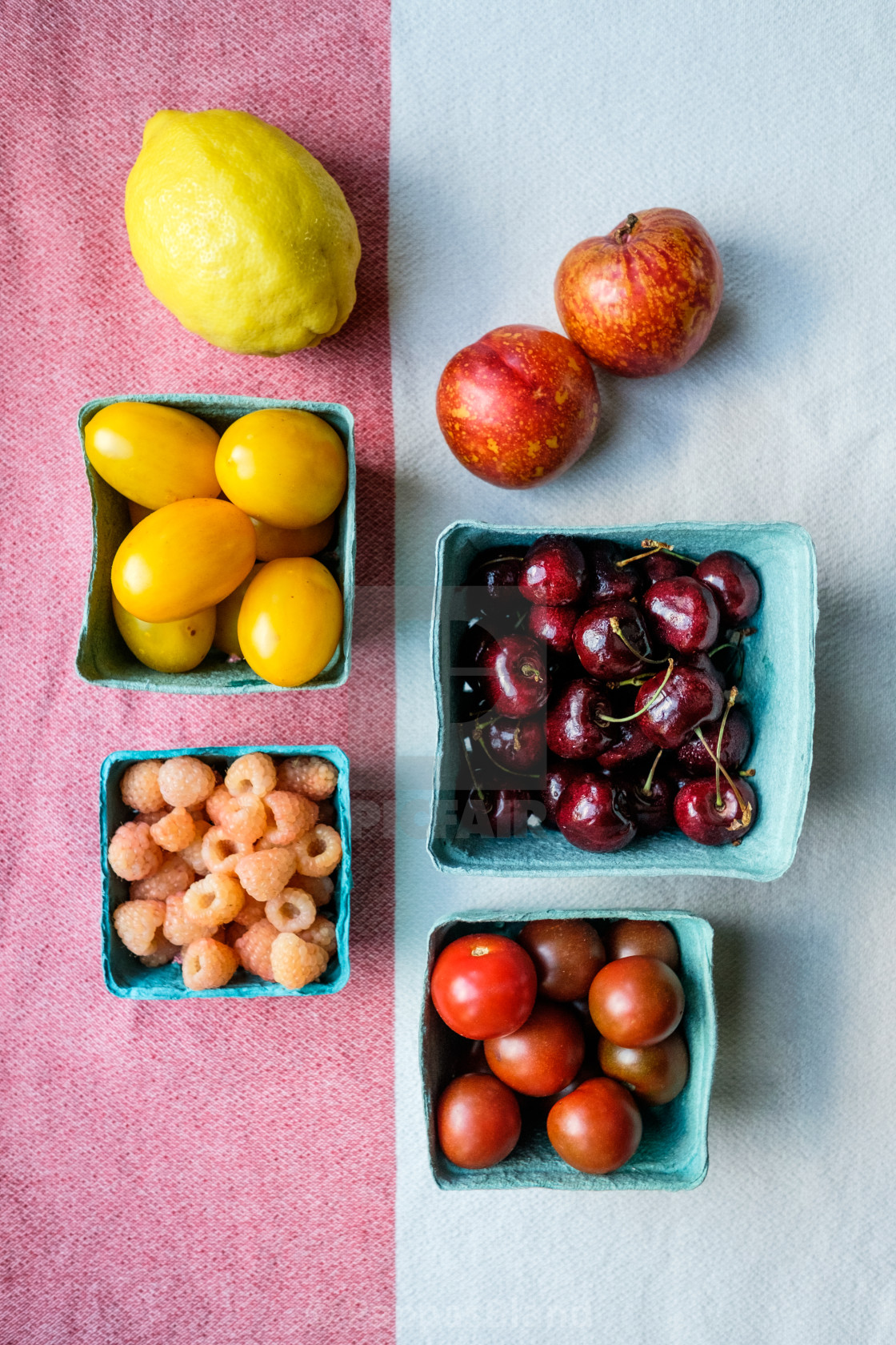"""""""A colorful still life of summer fruit and tomatoes."""" stock image"""