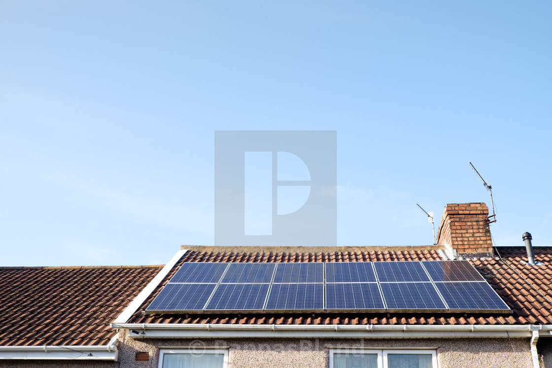 """""""Rooftop solar panels generating renewable energy on a sunny day in Bristol, England, UK."""" stock image"""