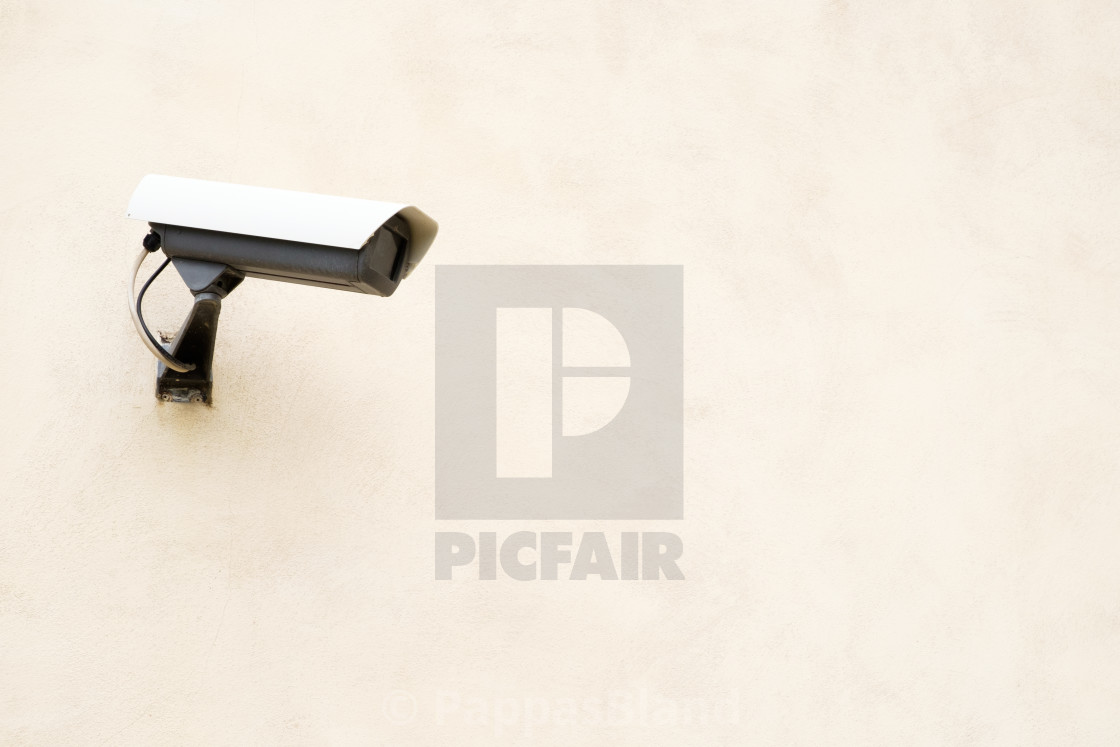 """""""A security camera keeps a watchful eye on visitors."""" stock image"""
