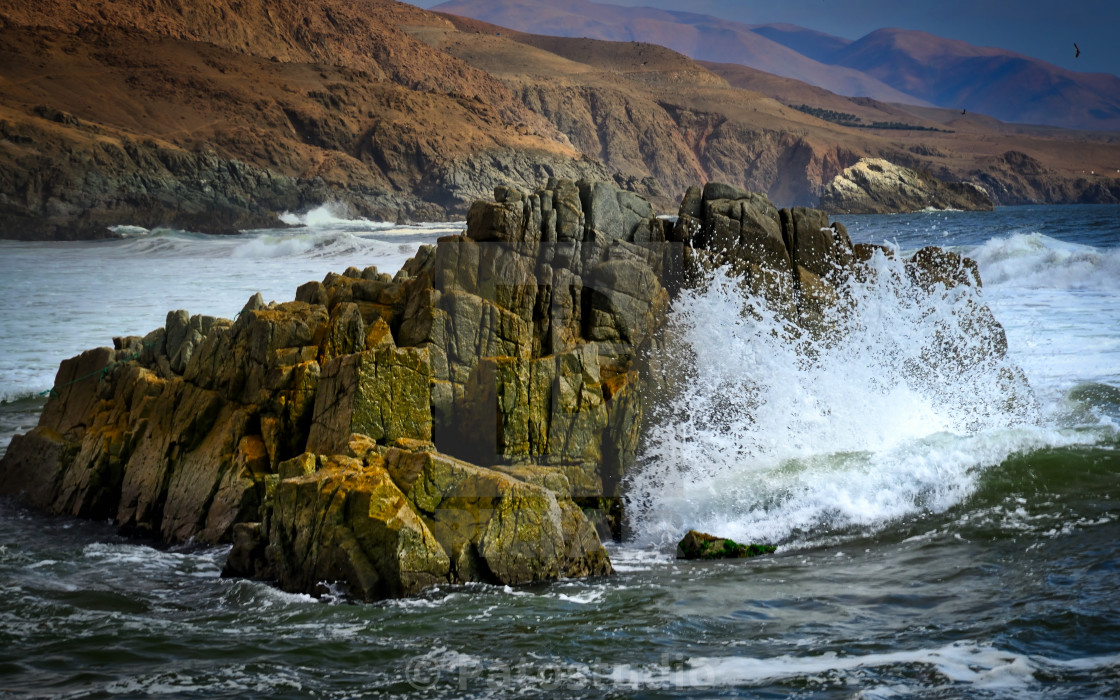 """waves breaking in rock"" stock image"