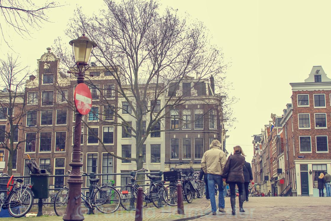 """""""Walking through Amsterdam"""" stock image"""