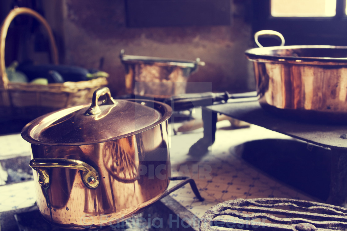 """Antique copper cooking pans"" stock image"