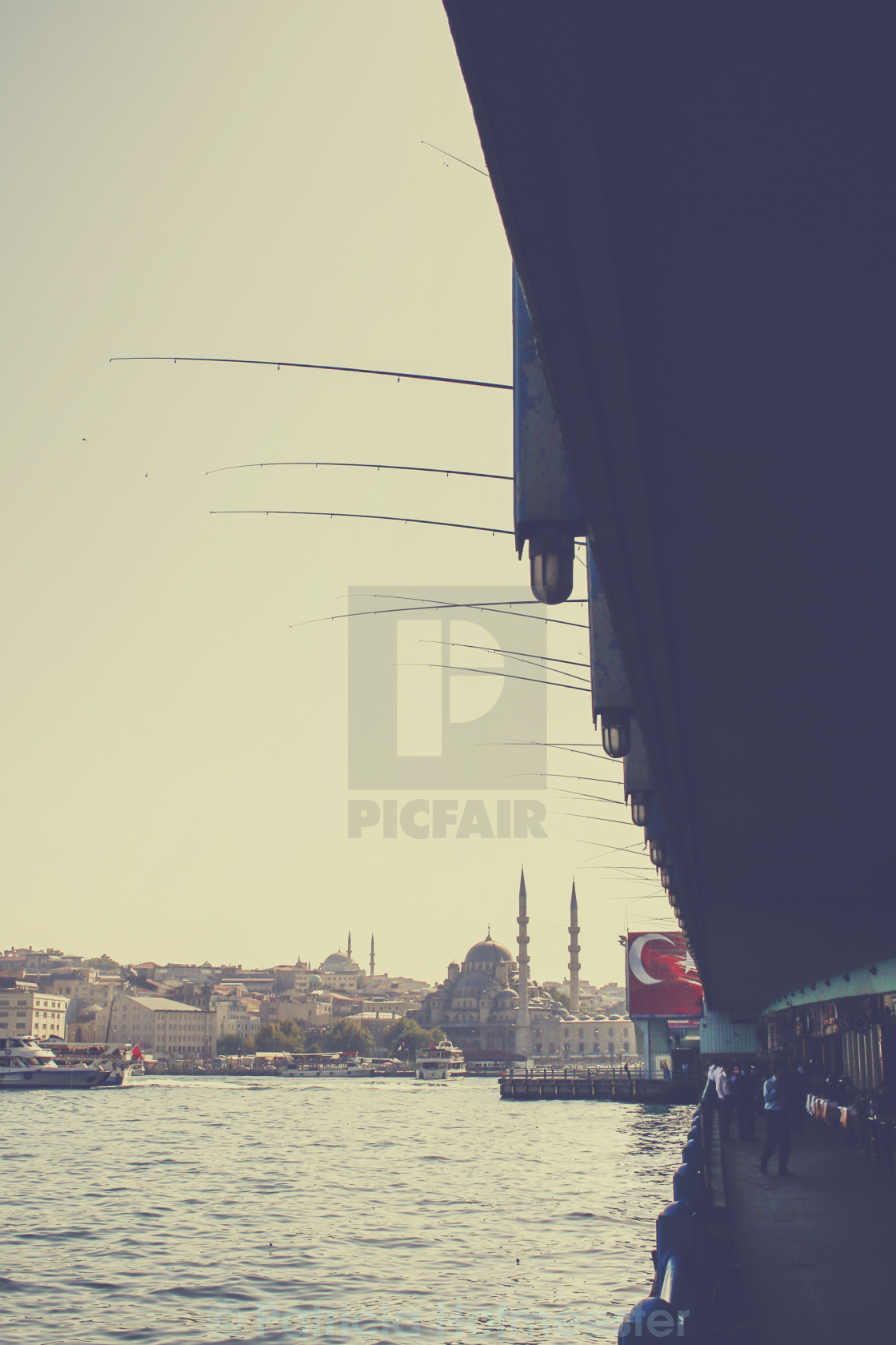 """Fishing on the Galata bridge in Istanbul"" stock image"