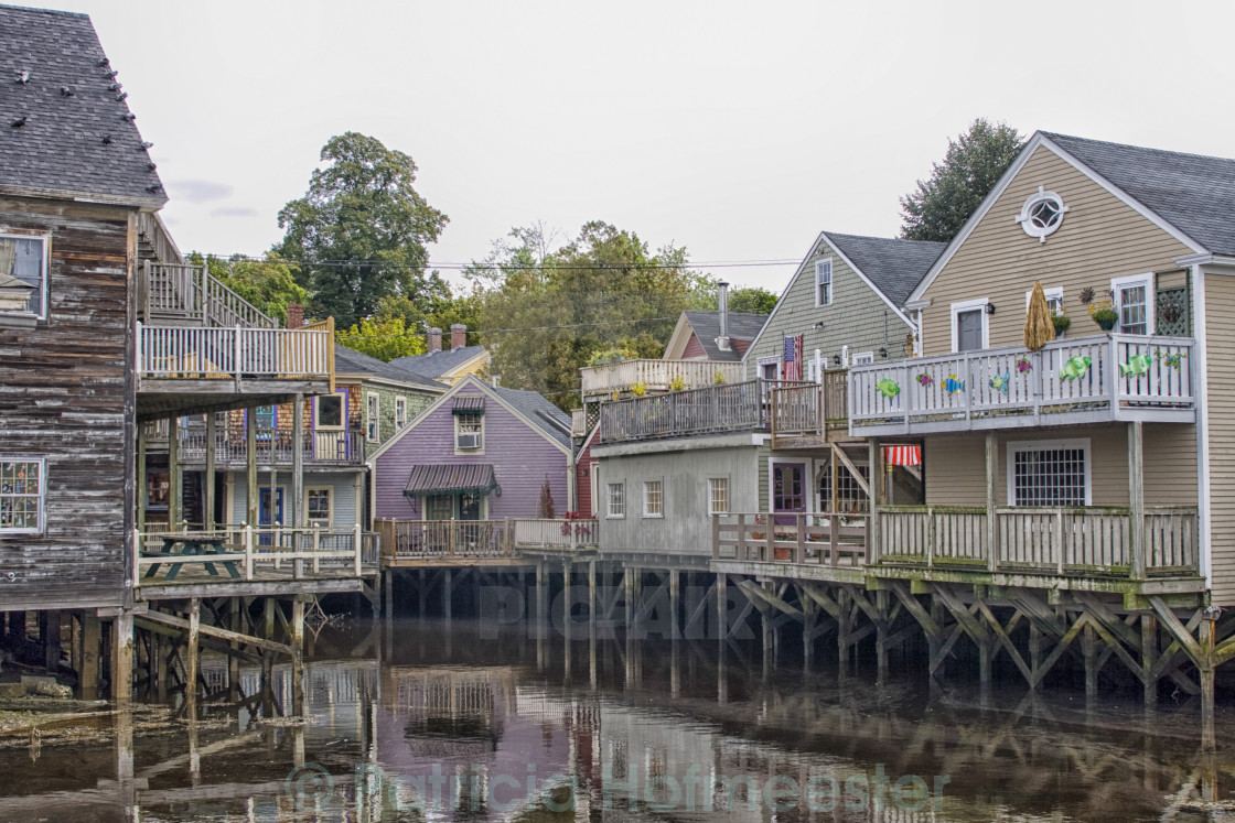 """Backside of wooden houses over water"" stock image"