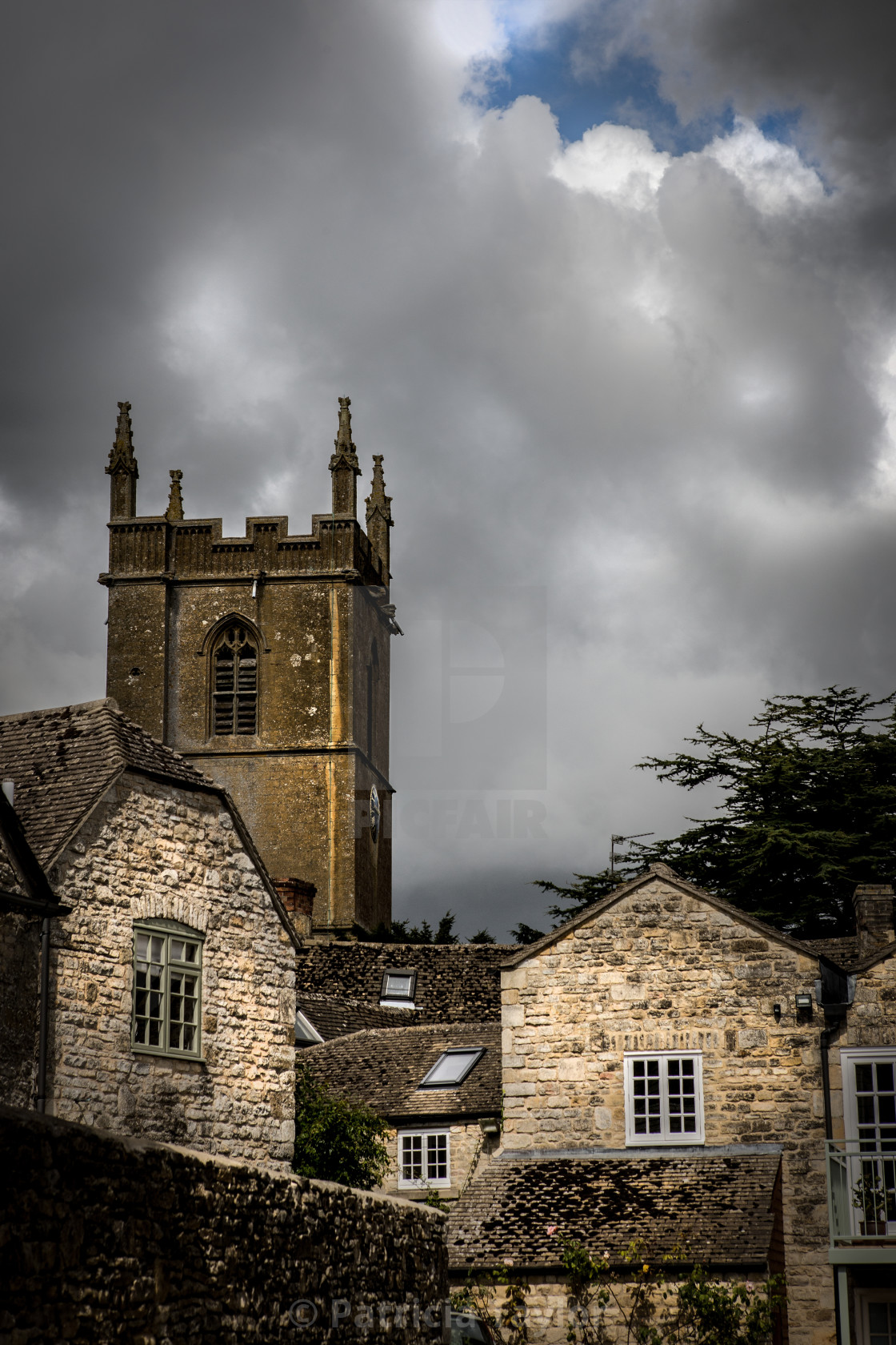 """Roof tops and church Scene - Stow on the Wold in the Cotswolds"" stock image"