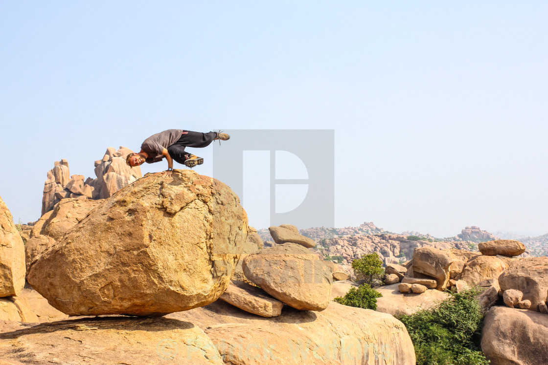 """Breakdancing on boulders"" stock image"