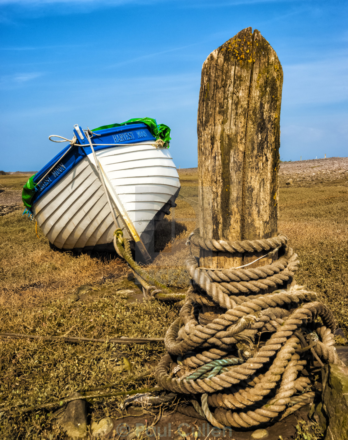 """""""Blue and white boat at Porlock weir."""" stock image"""