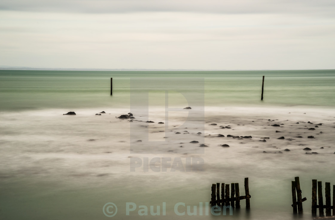 """Wooden posts in the sea."" stock image"