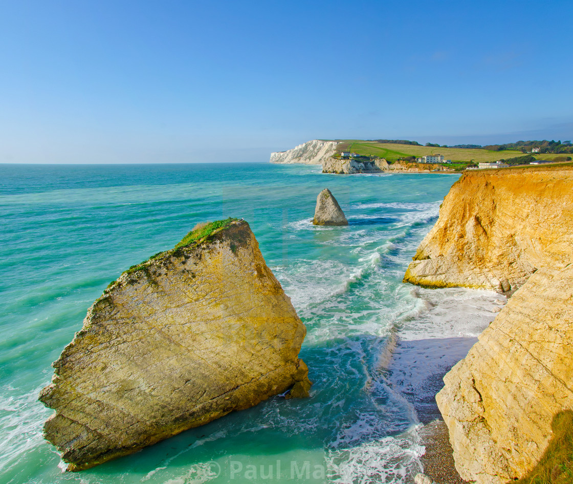 """Sea stacks at Freshwater Bay on the Isle of Wight. Looking west towards Tennyson Down."" stock image"