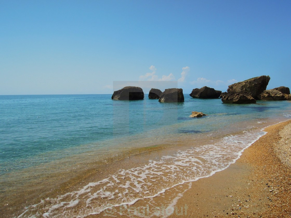 """A peaceful Greek beach"" stock image"