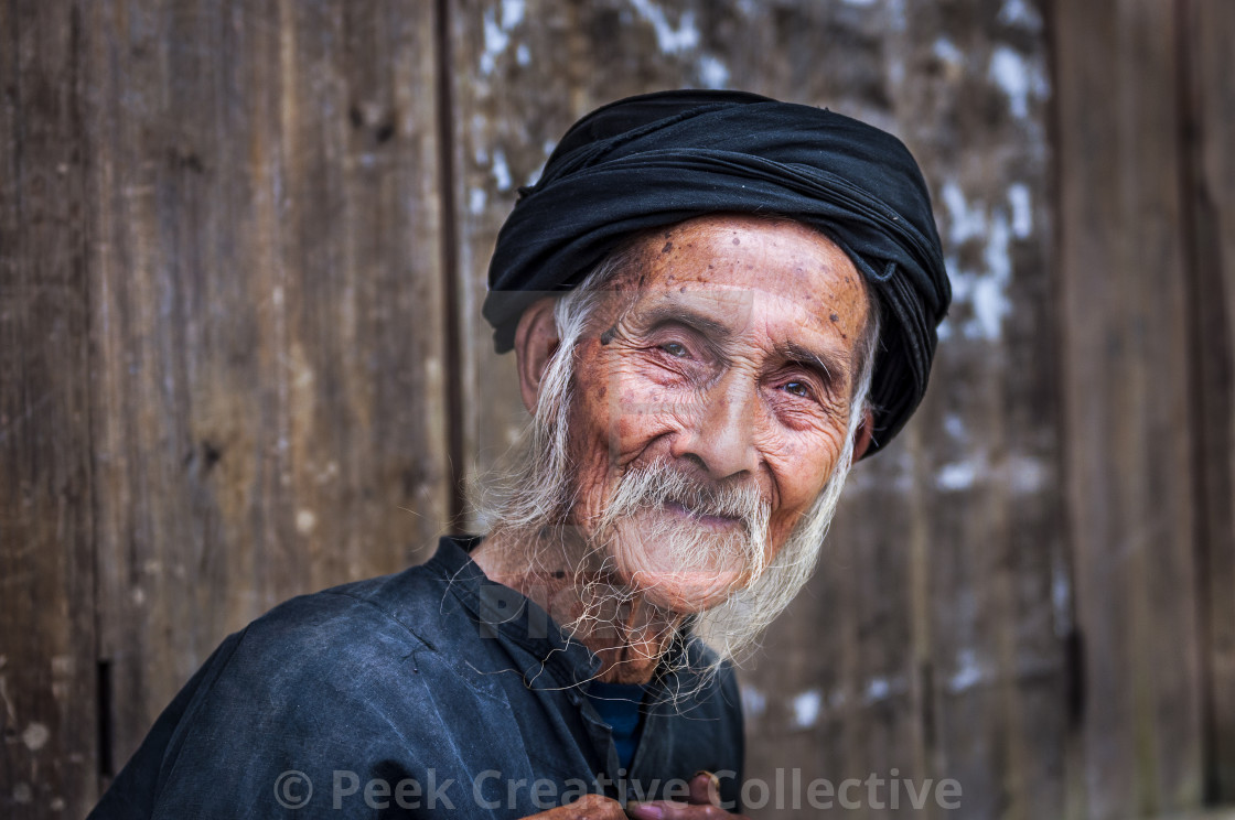 """Old Chinese man wearing traditional clothes in Dazhai, Guangxi, China; Concept for travel in China"" stock image"