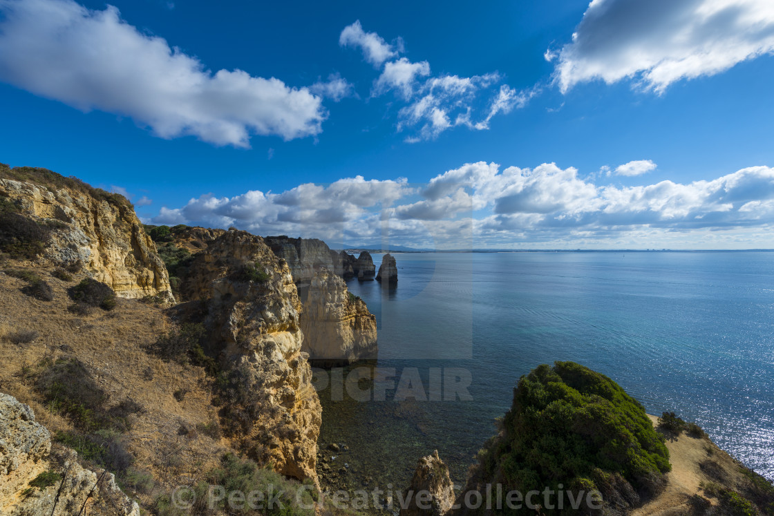 """View of the sandstone cliffs at the Ponta da Piedade and the Lagos bay in Algarve, Portugal; Concept for travel in Portugal and Algarve"" stock image"