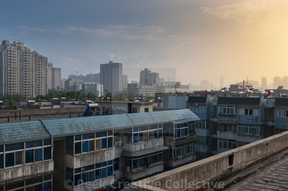 """""""Xian, China - August 6, 2012: View of the city of Xian at sunset, with residential buildings, in China, Asia"""" stock image"""