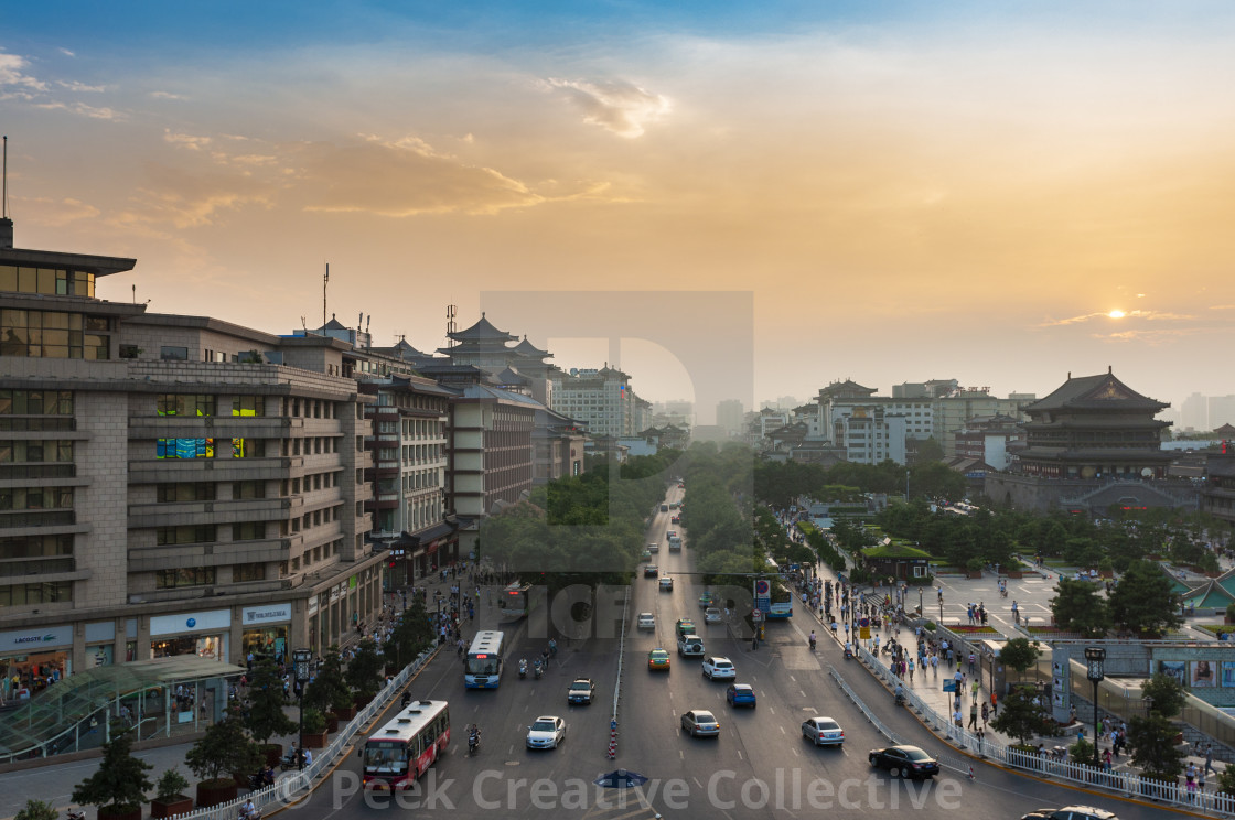 """""""Xian, China - August 6, 2012: Street scene in the city of Xian at sunset, with an avenue and a cars, in China, Asia"""" stock image"""