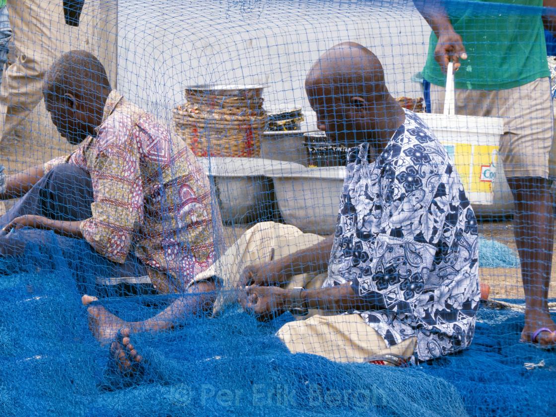 """""""Repairing fishing nets"""" stock image"""