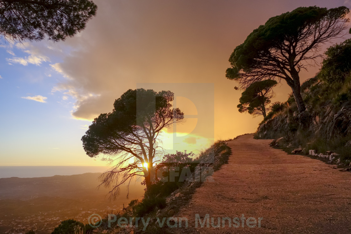 """Tarmac road in mountains of Mijas at sunset"" stock image"