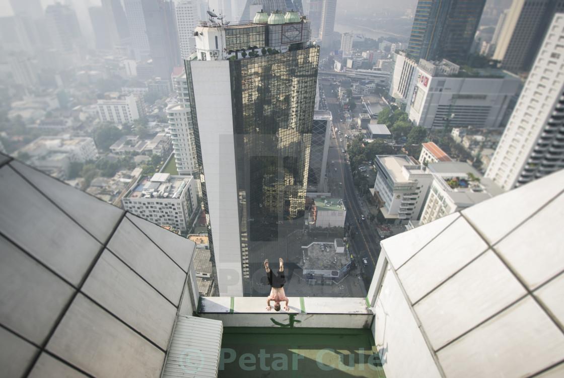 """Handstand on the edge of Bangkok"" stock image"