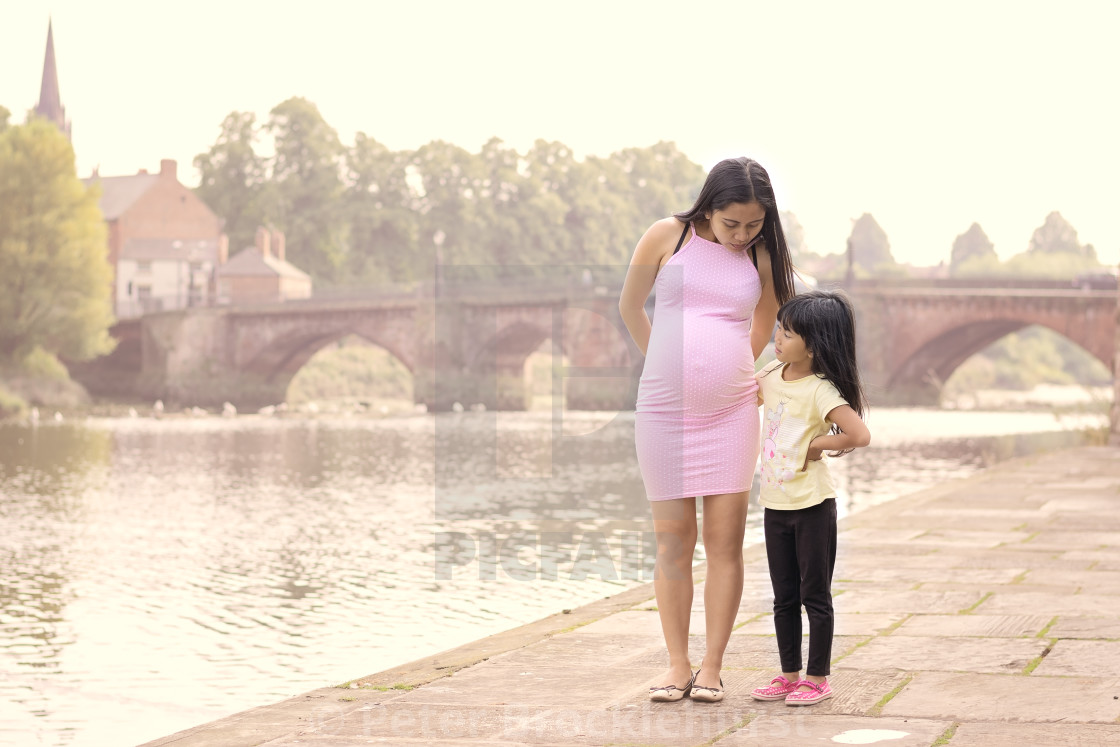 """""""Pregnant Mother and Daughter"""" stock image"""