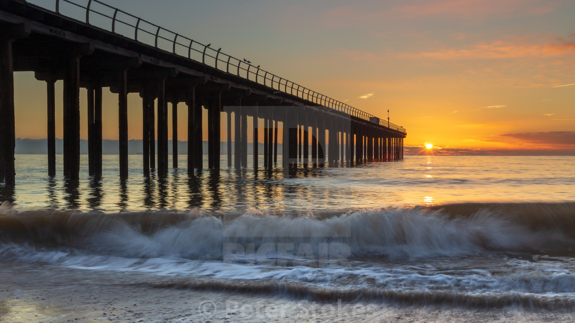 """Sunrise, Felixstowe Pier, Suffolk"" stock image"