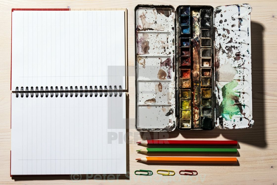 """""""Open Notebook, Pencil and Watercolor Paints"""" stock image"""