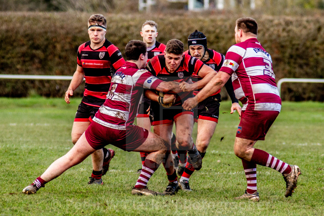 """Determination, teamwork, backup, resolve, Ilkley RFC vs Wirral RUFC, Player Tackled"" stock image"