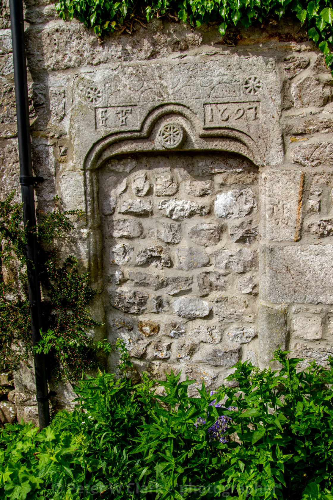 """""""Old Datestone 1607 over blocked entrance to building in Conistone"""" stock image"""