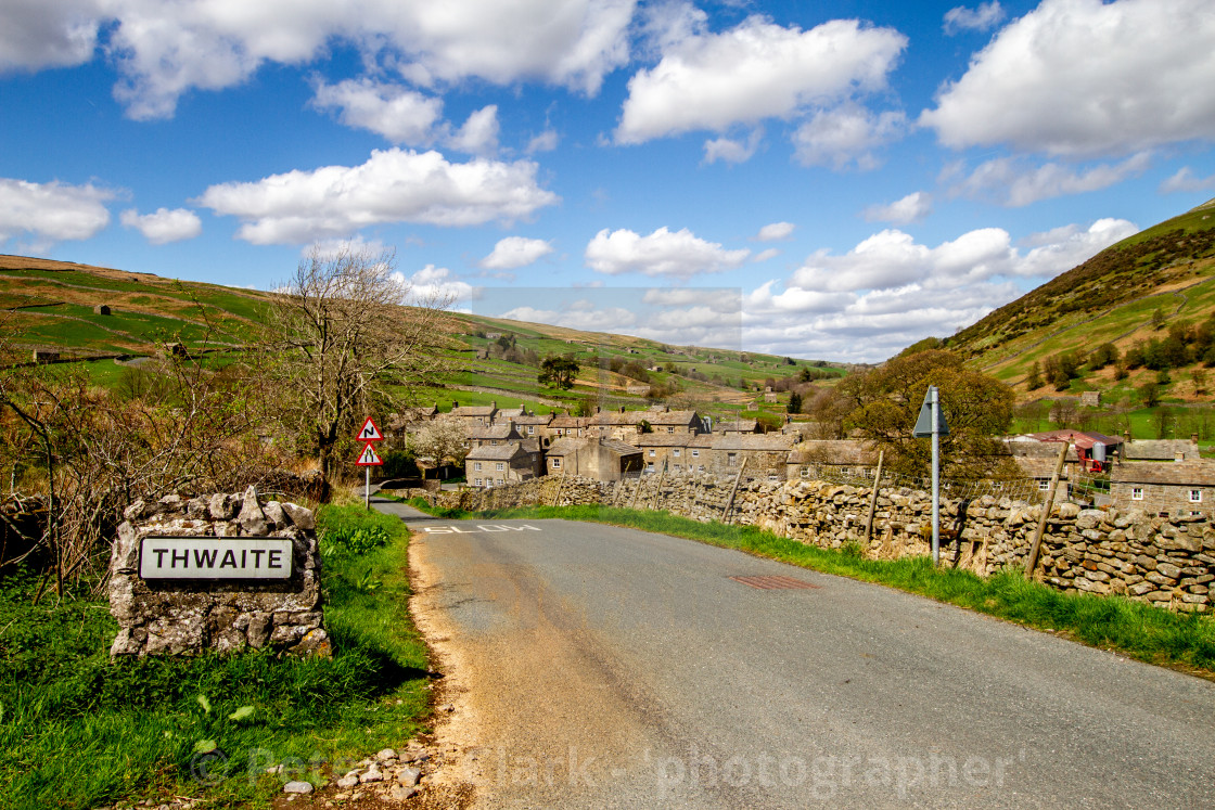 """""""Thwaite Village approaching by Road on a Sunny Day"""" stock image"""