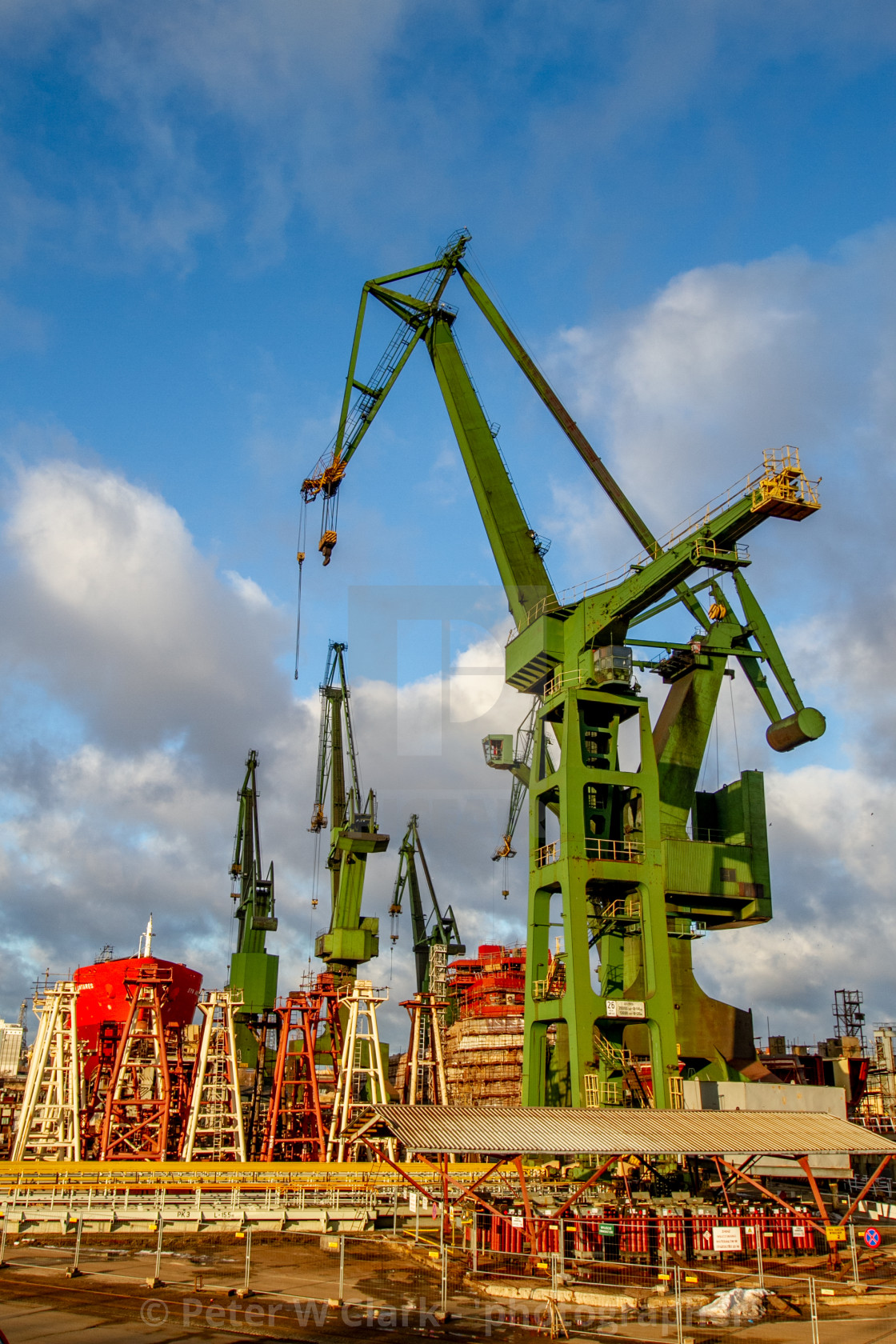 """Gdansk, Poland, Shipyard Cranes, Partially built ship in background."" stock image"
