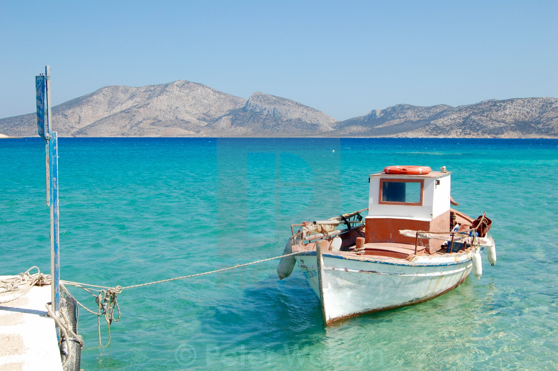 """Greek fishing boat moored in the Mediterranean Sea"" stock image"